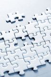Missing puzzle piece. Jigsaw puzzle assembled with a piece missing Stock Photos