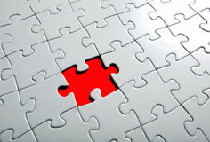 Missing puzzle  piece. Focus around the empty space Royalty Free Stock Photos