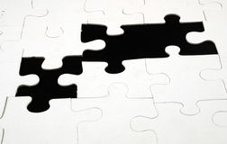Missing puzzle pieces Stock Photo
