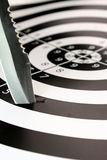 Missing the target. A machete that misses the center of the bullseye royalty free stock images