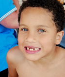 Missing Teeth. Gorgeous blue eyed young boy showes off his missing teeth Stock Photo