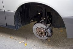 Missing tire. Car wheel well with missing tire removed for seasonal maintenance Royalty Free Stock Photography