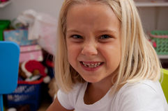 Missing a tooth. A little girl is missing a tooth Stock Image