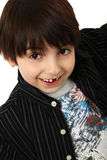 Missing Tooth. Happy dark haired caucasian six year old with missing tooth and shaggy hair Stock Image