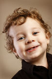 Missing tooth. A closeup of a cute 2 year old toddler with curly blond ringlets missing a tooth. Shallow DOF Royalty Free Stock Images