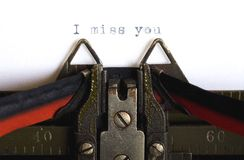 Missing you. Closeup image of I miss you typed with antique typewriter stock photography