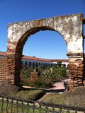 Mission Arch. Archway at California Mission in San Juan Capistrano, California. Gardens can be viewed stock image