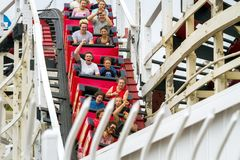 MISSION BAY, CA-USA-11 JULY 2018- People ride Giant Dipper Roller Coaster at Belmont Park. Several are screaming. The Mission stock photo