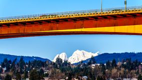 Mission Bridge over the Fraser River on Highway 11 between Abbotsford and Mission with snow covered Mount Robie Reid Royalty Free Stock Image