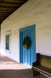 Mission Christmas. Evergreen wreath on door in California Mission Stock Photos