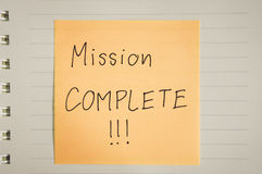 Mission complete words on paper. Hand written mission complete words and exclamation marks on paper, colored filter effect stock photo