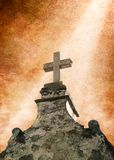 Mission Cross. A beam of light on an ancient stone cross stock photo