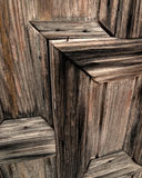 Mission door. Aging weathered wood relief on church door Royalty Free Stock Images