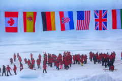 Mission is over: flags of all participating countries tremble at the North pole. Back guards against polar bears Stock Photos