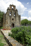 Mission and plants. Mission Espada with a wall and plants Royalty Free Stock Photo
