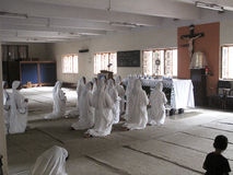 Missionaries of Charity in the chapel of the Mother House, Kolkata Royalty Free Stock Photo