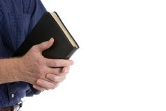 Missionary With Bible. Missionary man holds his bible with interlocked fingers to pray Royalty Free Stock Images