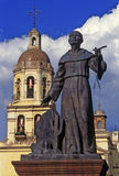 Missionarys monument. Statue of missionary and templo de la Cruz in Queretaro royalty free stock photo