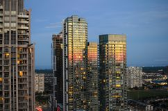 MISSISSAUGA, CANADA, JUNE 12, 2016: View to skyscrapers with sun. Set reflected in the windows Royalty Free Stock Images