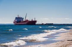 Tanker ship docked near beach on Lake Ontario. Royalty Free Stock Image