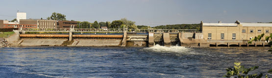 Mississippi Dam Panorama. Panorama of a Mississippi River dam with an adjoining 100 year old paper mill in St. Cloud, Minnesota, USA Stock Image