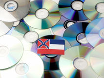 Mississippi flag on top of CD and DVD pile isolated on white. Mississippi flag on top of CD and DVD pile isolated Royalty Free Stock Image