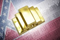 Mississippi gold reserves. Shining golden bullions lie on a mississippi state flag background Stock Photos