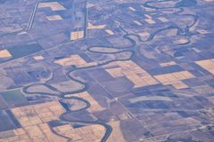 Free Mississippi River Aerial Landscape Views From Airplane Over The Border Of Arkansas And Mississippi. Winding River And Rural Town A Stock Photography - 167595382