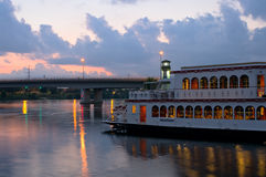 Mississippi River and Boat at Sundown. Riverboat on Mississippi River docked on Boom Island at dusk with Plymouth Avenue bridge in background in Minneapolis stock images