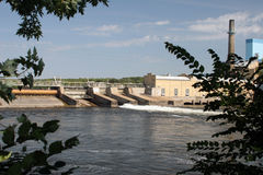 Mississippi River Dam. Panorama of a Mississippi River dam with an adjoining 100 year old paper mill in St. Cloud, Minnesota, USA Royalty Free Stock Photo