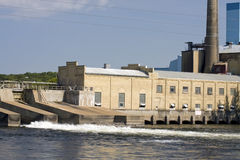 Mississippi River Dam. Panorama of a Mississippi River dam with an adjoining 100 year old paper mill in St. Cloud, Minnesota, USA Royalty Free Stock Photos