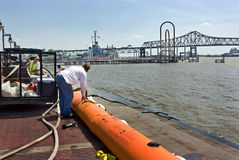 Mississippi River flood preparation. Mississippi River, Baton Rouge, Louisiana,  5-12-11.  An 18 high bladder (Tiger Dam) is filled with river water and weighed Stock Image