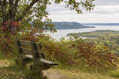 Mississippi River Lake Pepin. A park bench onlooking Lake Pepin on the Mississippi River during early autumn Stock Photography