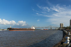 Mississippi River in the New Orleans riverfront with cargo ships navigating in the river. New Orleans, Louisiana, USA - June 17, 2014: View of the Mississippi Stock Images