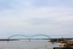 Mississippi River. A view of a bridge on the Mississippi with a steamboat in Memphis, Tennessee stock photos
