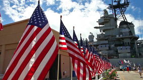 Missouri Battleship memorial flags. American flags at Missouri Battleship Memorial in Pearl Harbor Honolulu Hawaii, Oahu island of United States. National stock video footage
