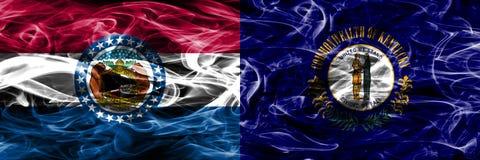 Missouri contra las banderas coloridas del humo del concepto de Kentucky colocadas de lado a lado imágenes de archivo libres de regalías