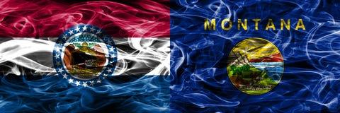 Missouri contra las banderas coloridas del humo del concepto de Montana colocadas de lado a lado fotos de archivo libres de regalías