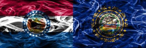 Missouri contra las banderas coloridas del humo del concepto de New Hampshire colocadas de lado a lado fotos de archivo libres de regalías