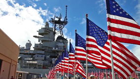Missouri memorial flags. HONOLULU, OAHU, HAWAII, USA - AUGUST 21, 2016: Battleship Missouri Memorial with American flags at Pearl Harbor in Honolulu Hawaii, Oahu stock footage