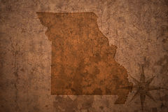 Missouri state map on a old vintage paper background. Missouri state map on a old vintage crack paper background Stock Photos