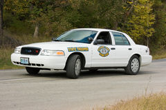 Missouri State Trooper Police Car. A white Ford Crown Victoria Missouri State Police trooper automobile parked in the middle of the road Stock Photos