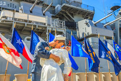 Missouri victory kiss statue. HONOLULU, OAHU, HAWAII, USA - AUGUST 21, 2016: victory kiss statue at battleship Missouri Memorial with flags at Pearl Harbor Royalty Free Stock Images