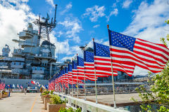 Missouri Warship memorial flags. American flags in line at Missouri Warship Memorial in Pearl Harbor Honolulu Hawaii, Oahu island of United States. National Royalty Free Stock Photo