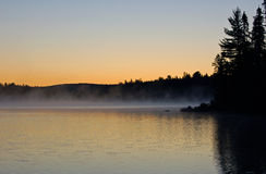 Mist. Sunrise and mist in beautiful lake in Algonquin Park Stock Photos
