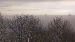 Mist above industrial city. Cloudy and depressive landscape stock footage