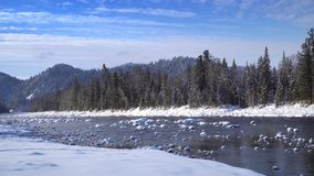 Mist above the Snowy Mountain River. In Winter Morning stock video