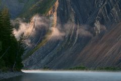 The mist along the rocky shores of the river. Stock Photography