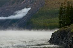 The mist along the rocky shores of the river. Stock Photo