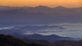Mist with big mountain in the morning Royalty Free Stock Images